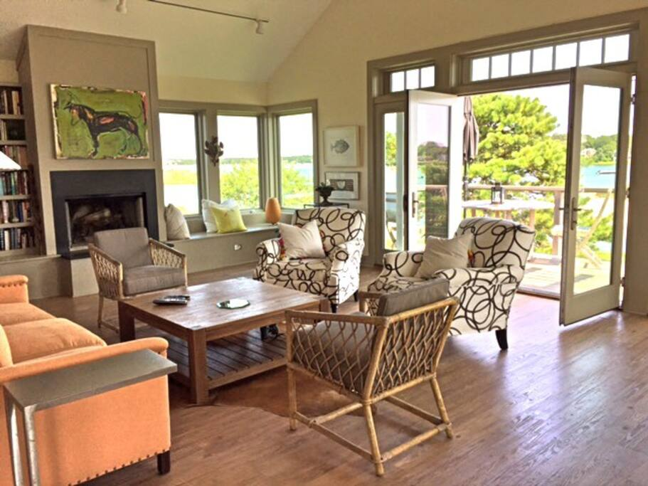 Living Room with Large Open doors to private deck overlooking the water