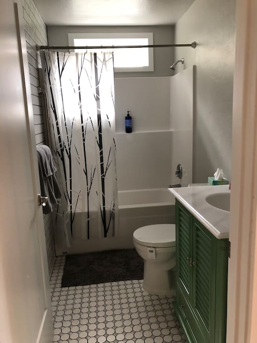 Full bath with tub and shower.