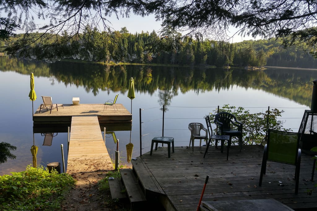 View of the dock and deck from the  path down to the lake