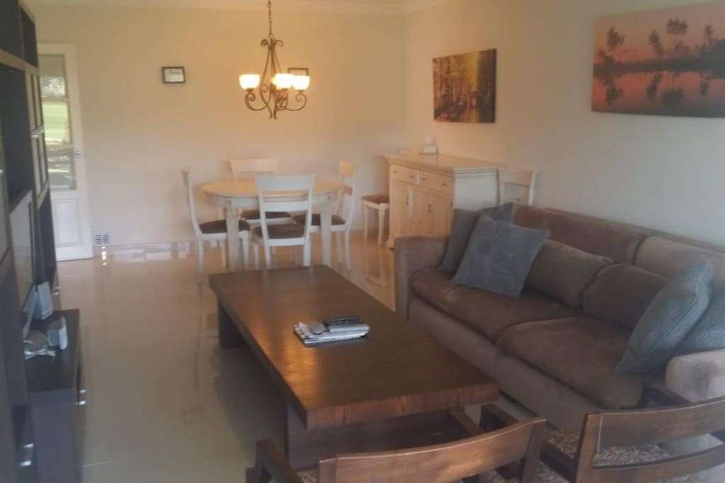 Combined Living & Dining room, with direct access to terrace & garden, aloha golf and mountain view.