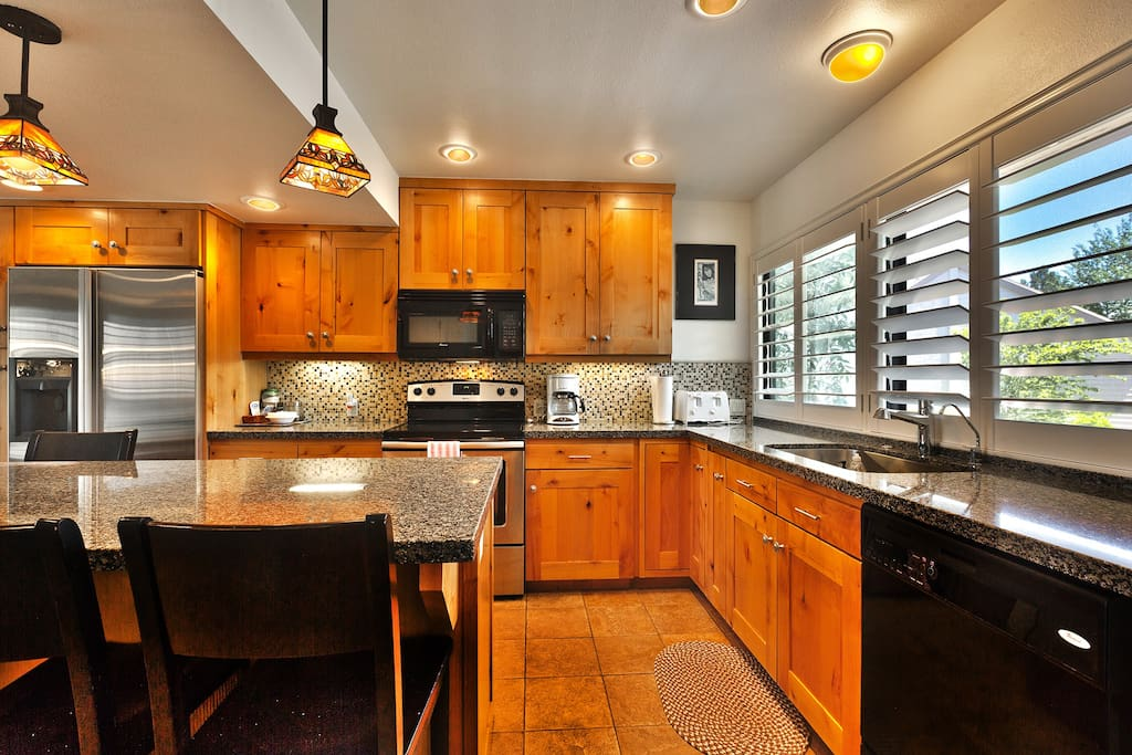 Kitchen with plenty of natural light, Plantation shutters, and all the small appliances you need to start your day.