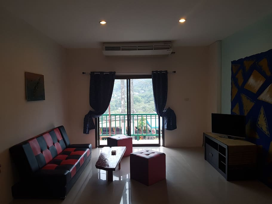 living area with tv and aircondition