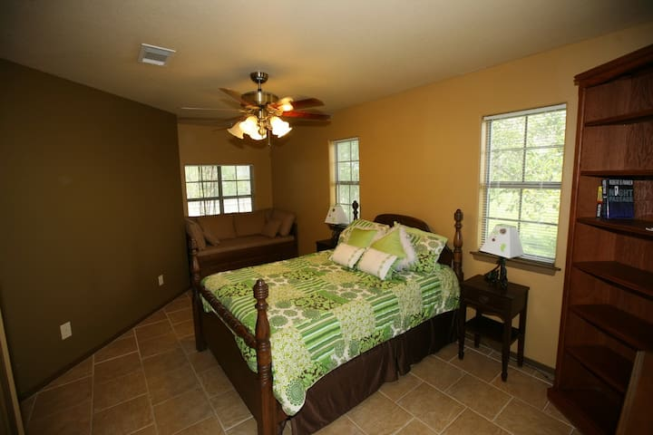 Guest (2nd) bedroom with a comfortable double bed for 2 adults and a trundle bed for 2 children.