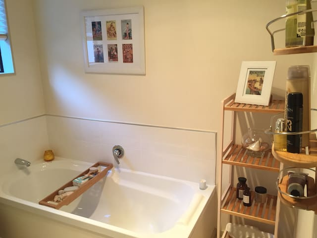 The bathroom - full size bath and separate shower.  Quality toiletries and fluffy white Sheridan towels and scented candles are included.