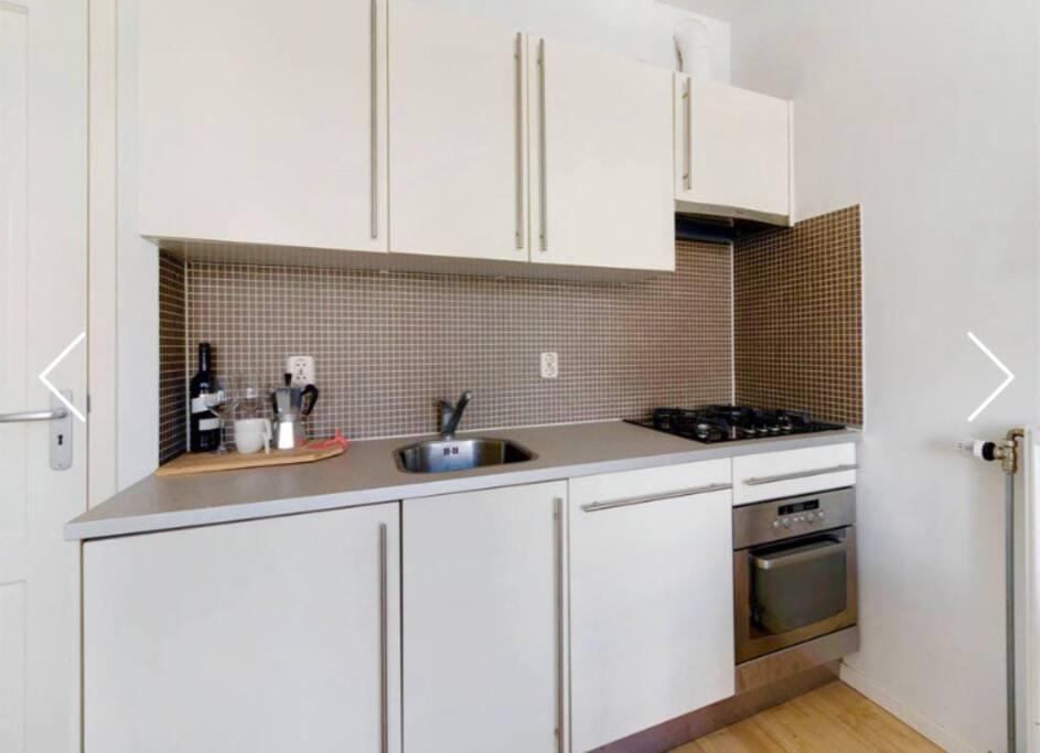 Full  kitchen with fridge , oven and dishwasher