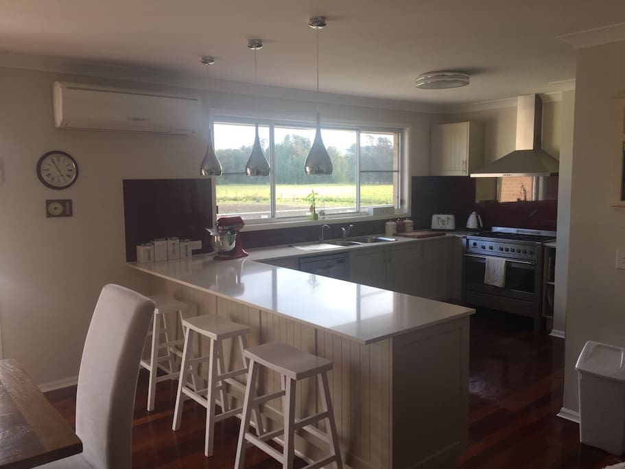 Fully equipped kitchen with stone bench tops, dishwasher and 900mm gas range.