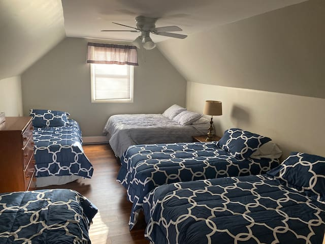 This bunk room has  a double bed and 4 twin beds with additional under bed storage.