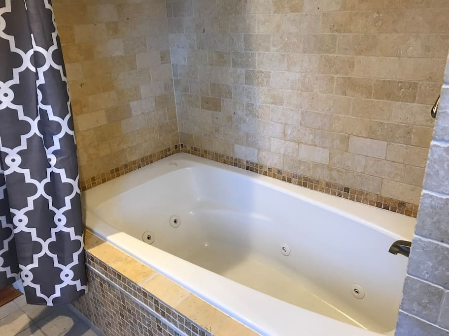 Take a bath in the jacuzzi tub. It's deep and relaxing - absolutely perfect for pampering yourself.
