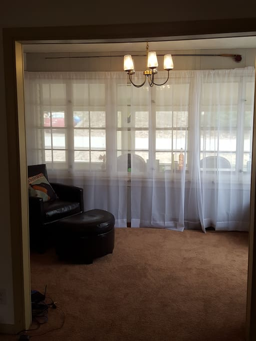 Den off living room. Curtain can be closed for privacy. Beautiful lake views.