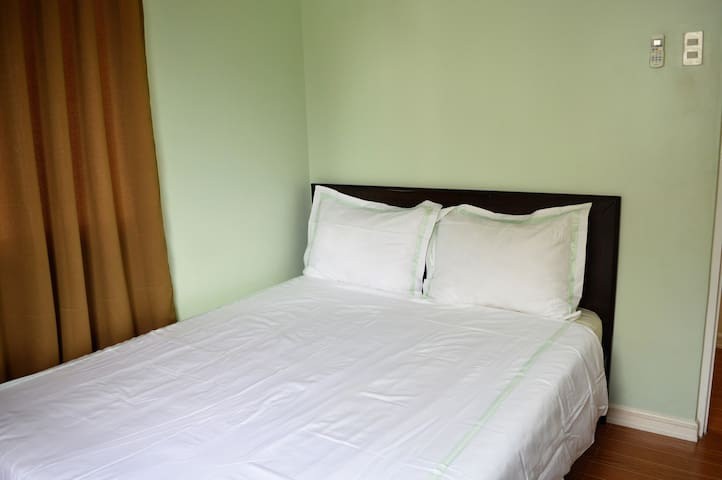 Bedroom 3 with queen size bed and good quality spring mattress, linens and duvet. With split type aircon.