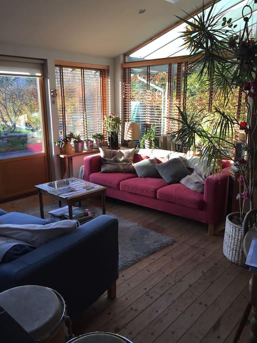 Open plan sitting room /Kitchen, opening onto the garden
