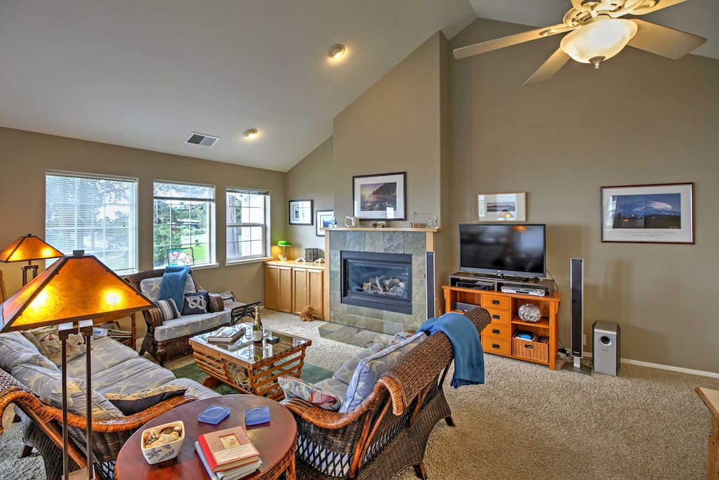 Warm your toes by the gas-burning fireplace as you watch TV on the flat screen DirecTV.