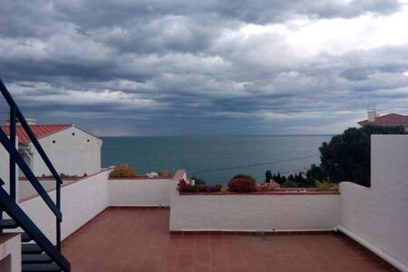 Large terrace next to the beach 5 minutes walk