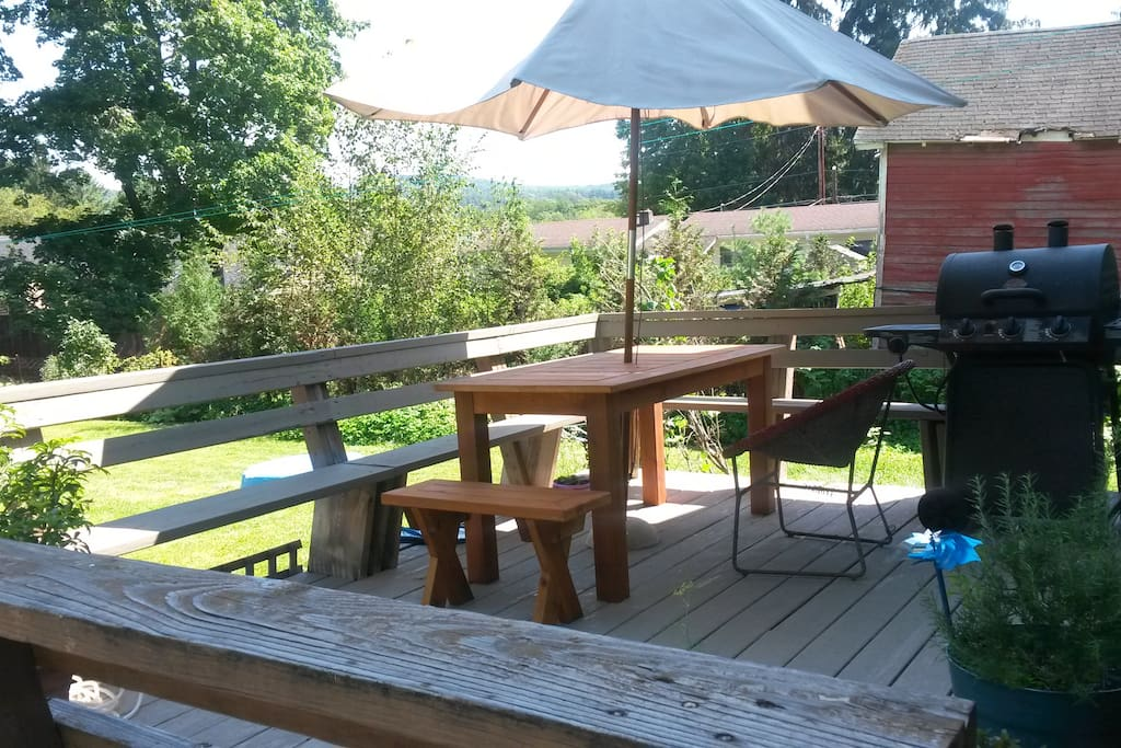 Outside deck with gas grill, picnic table and wonderful view of the hills