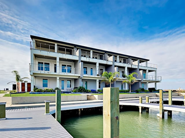 Your corner unit getaway features a private boat dock with access to the Gulf.