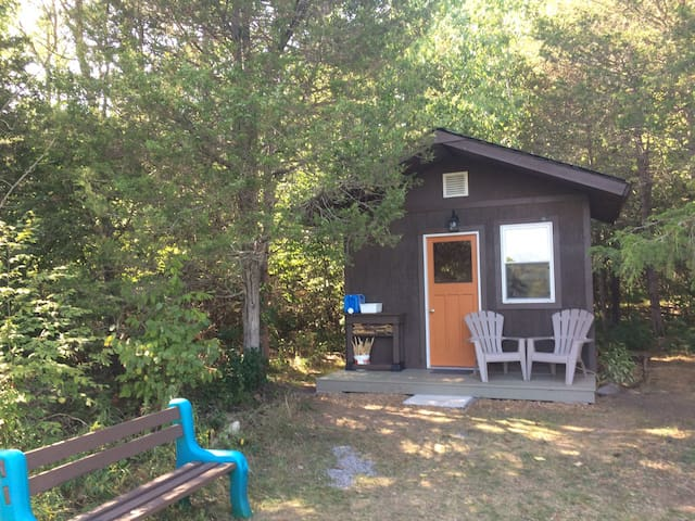 The cabin has a washstand, Adirondacks, bench, fire pit and picnic table to help you enjoy the outdoors. A water stand is available to refill water jug.