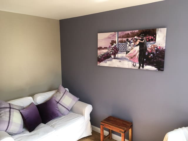 Stylish welcoming apartment with parking & garden