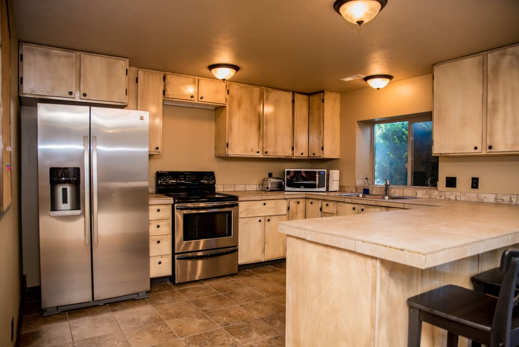 Full size kitchen with full size appliances.