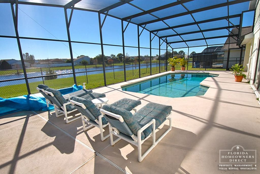 Lounge by the pool area with your kids playing in the pool and enjoy the Florida weather- Heat can be added to the pool with additional fee