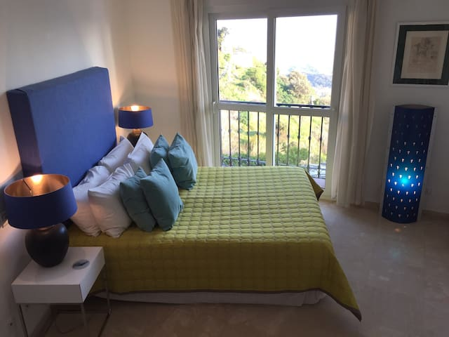 Double bedroom with fabulous views to the sea from your bed!