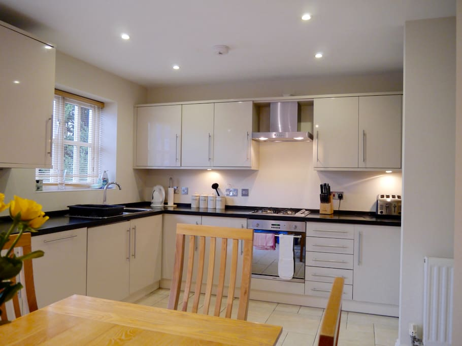 The kitchen is fully equipped with a dishwasher, microwave, cooker, hob and large fridge/freezer. Crockery and table settings for six.