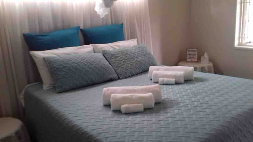 Master bedroom with queen bed and ensuite bathroom.