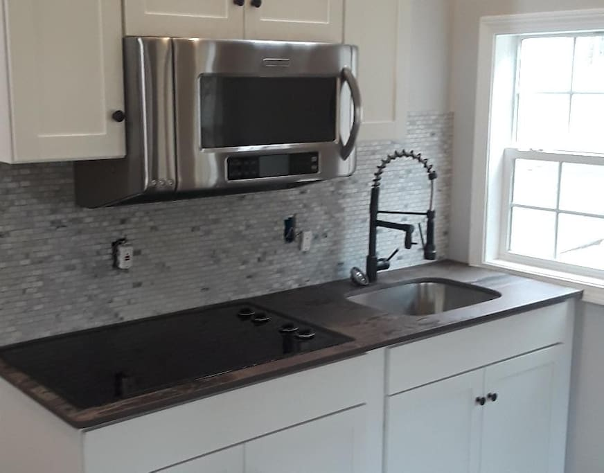 Brand New Kitchennette with beautiful countertops.  I decided to go with an industrial-mixed stone/slate theme.