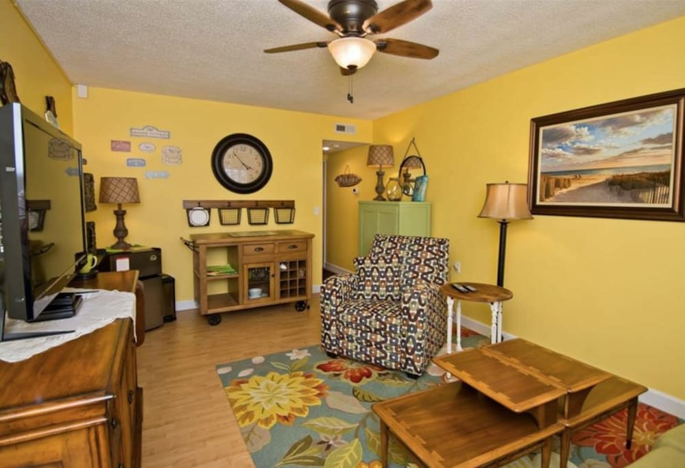 Living room/kitchenette with Keurig coffee maker, convection oven, electric grill, microwave and refrigerator.