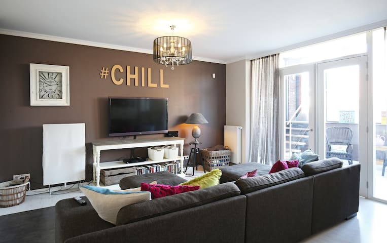 Relax on the huge couch and watch TV on a big screen.  #chill