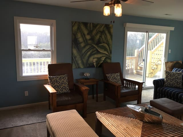 Living Room / Great Room, Stairs to roof top deck, can be seen through sliding glass doors. Second Floor