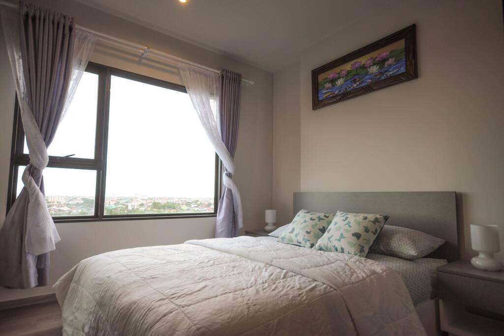 Comfy bedroom with nice breeze.