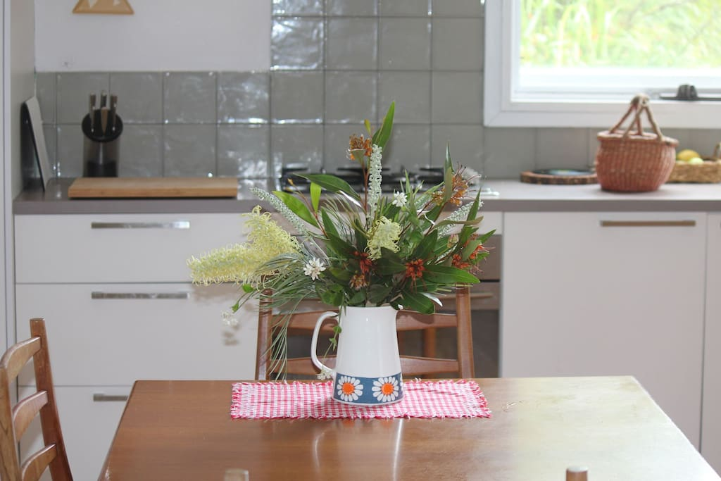 Seasonal flowers from our place greet you in the kitchen!