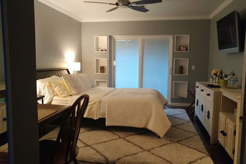 Large Master Suite.  Sliding doors to pool area.