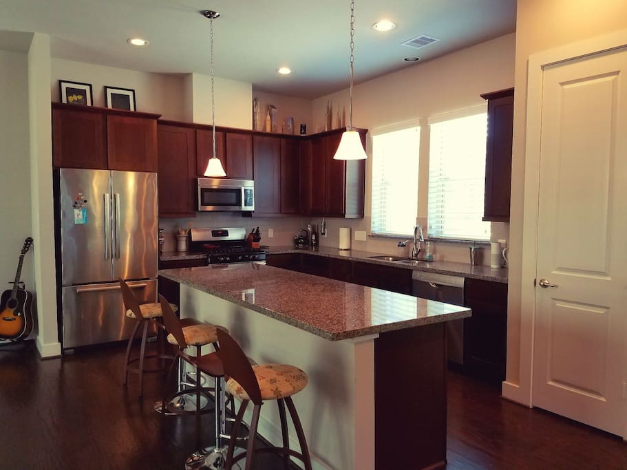 Fully furnished kitchen, with security camera located on top of cabinets.