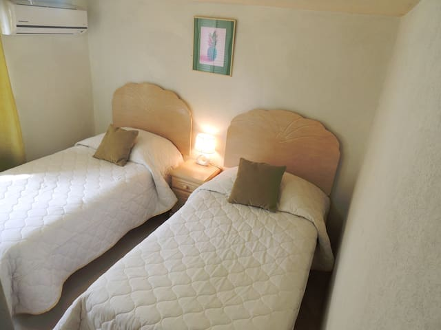 (3rd) Bedroom located on the right as you enter the lower level - (2) Single beds (can be made into King) A/C, built in closet, side table & lamp.