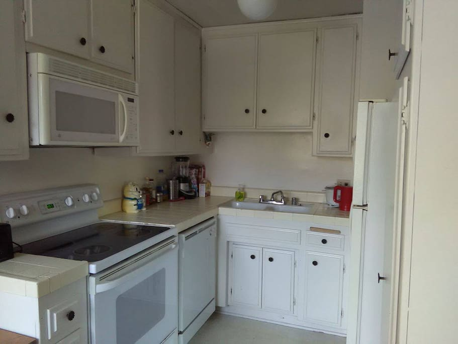 The kitchen with oven, dishwasher and microwave. You are welcome to cook here. :)