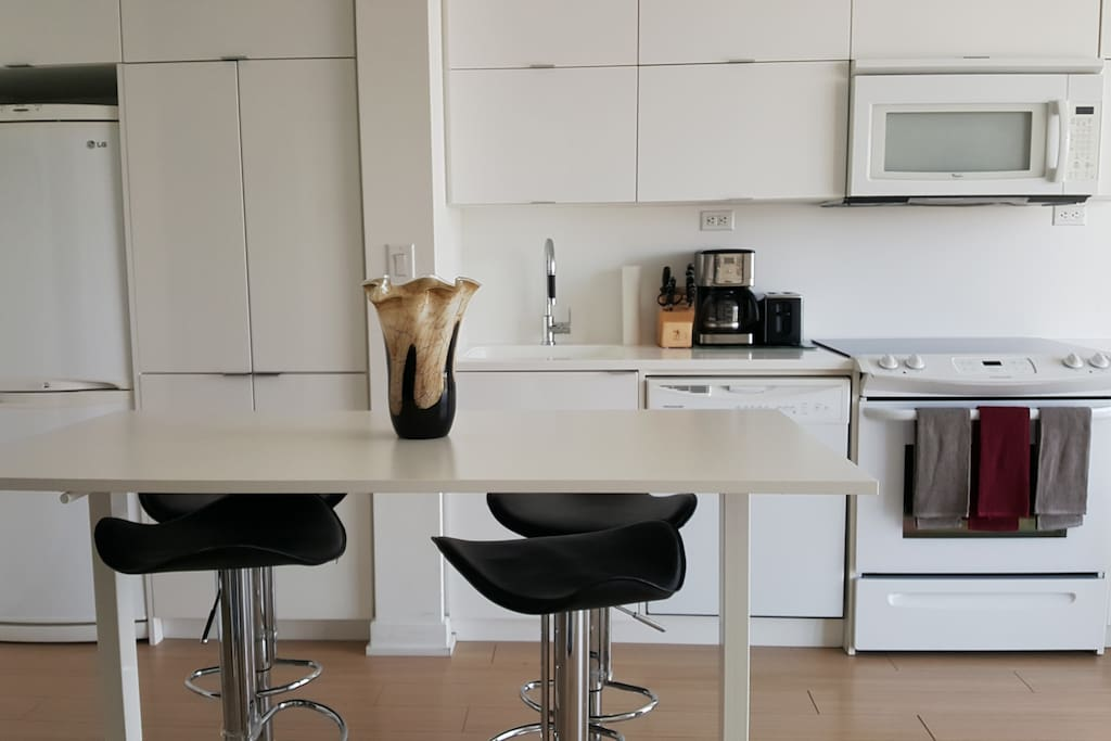 The kitchen has a dining area to comfortably seat four people.