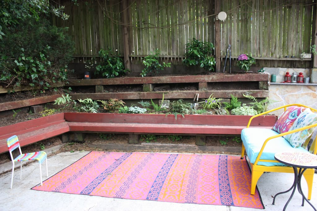 Bench circles entire yard, plus outdoor loveseat for relaxing.