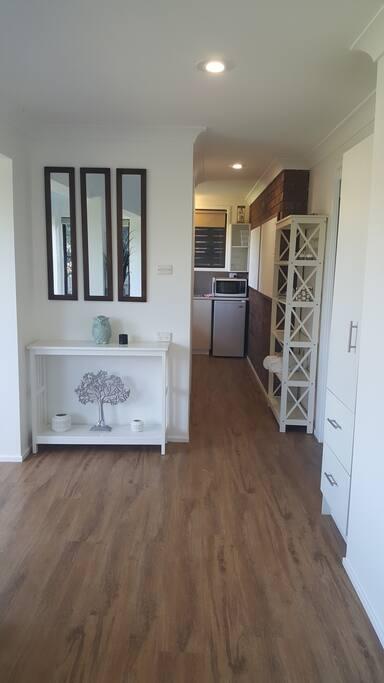 Hallway leading to bathroom and kitchenette