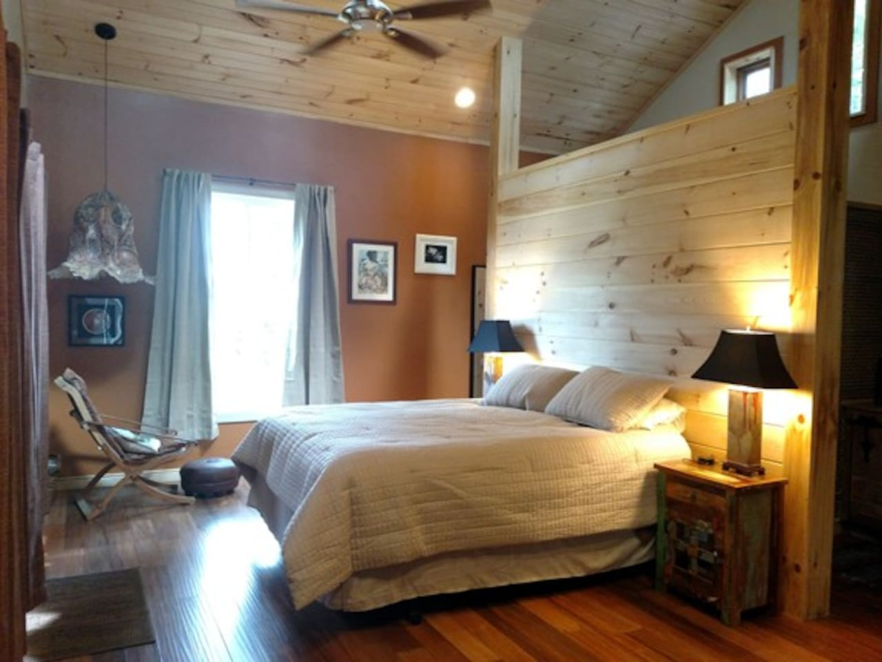 Spacious bedroom suite with queen size bed, private bath.