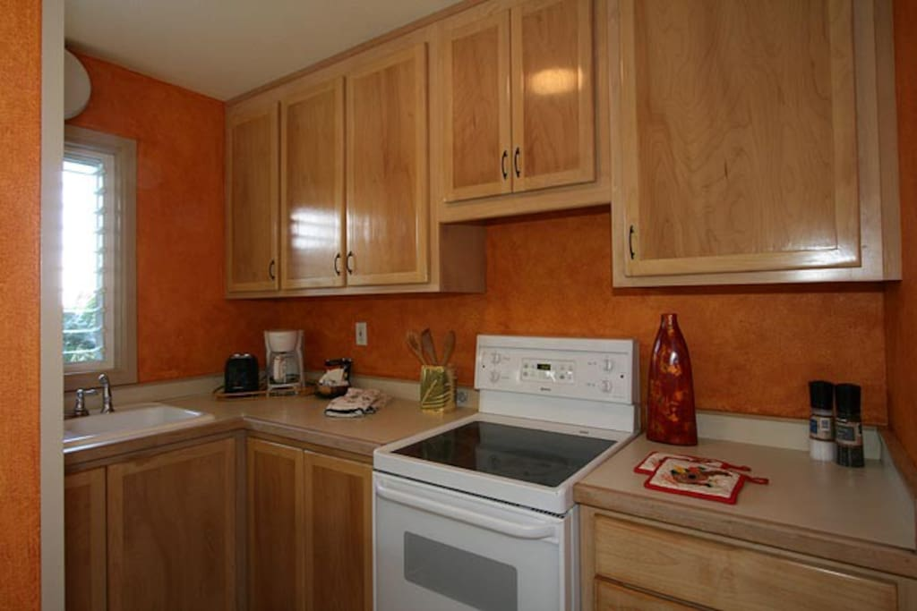 Fully stocked kitchen with apartment size appliances
