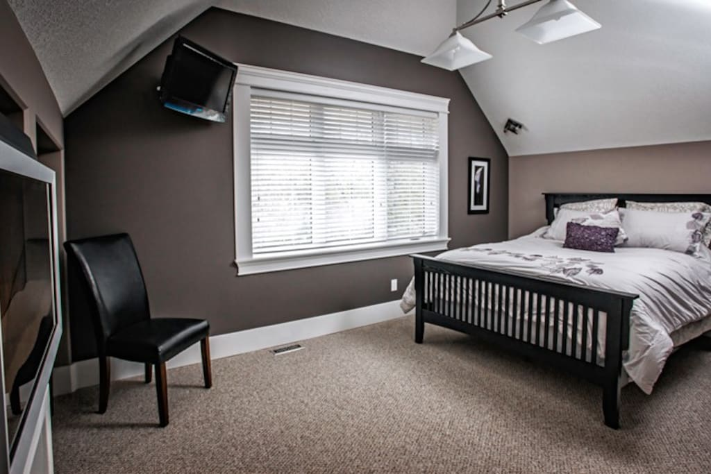 "Master Bedroom has a large closet, a desk, a 32"" plasma television and an electric fireplaec"