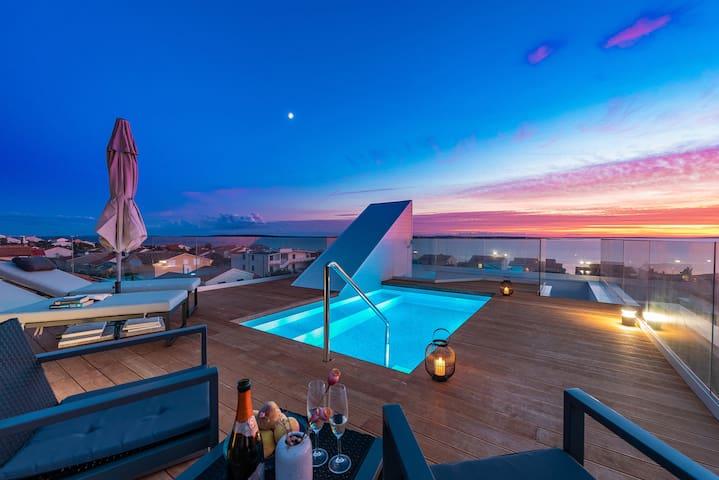 Bekina, roof top pool stylish house