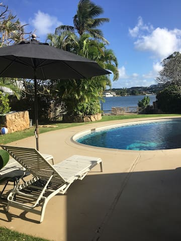 Waterfront with pool and lake view