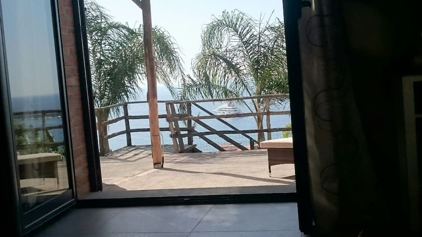 Your view from the living room glass door, a good view through the palm trees on the sea and the yachts