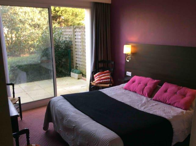 Chambre avec terrasse en Rez de jardin