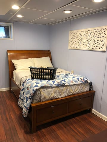 Full size bed in bedroom. Bath towels and toiletries included.