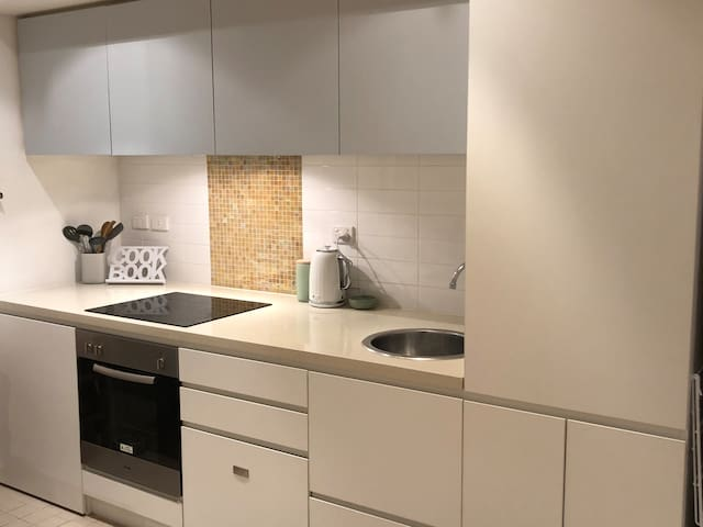 New kitchen with all the appliances and amenities!! Electric stovetop and full size oven and a built in dishwasher. What more could you need for a home away from home?