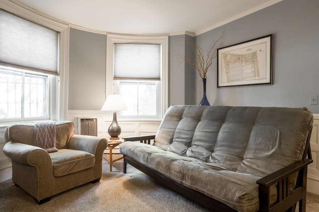 Two large windows in the living room provide natural light. Easy to lower cellular shades darken room when used as a bedroom. Two can sleep comfortably on this thick queen size futon.
