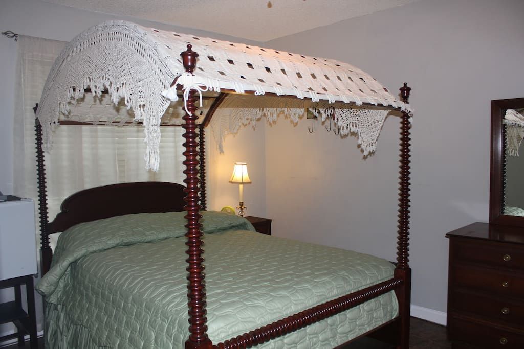 You will be extra comfortable in this charming vintage private bedroom.